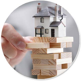 Jenga with a small house sitting on top