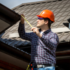 man inspecting roof